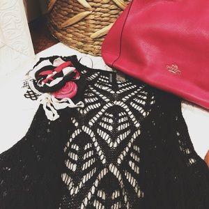•Black vest•
